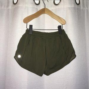 Olive green Lululemon running shorts
